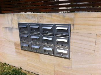 Stainless Steel Letter Boxes inserted into Stone wall